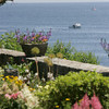 Seaside Gardens Tour 2009: Garden of Nancy Strisik  at 89 Marmion Way in Rockport provides magnificent views of the water including a view across Whale Cove to the twin lighthouses on Thatcher Island. Photo by Mary Muckenhoupt