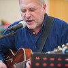 John Hicks plays the guitar an sings with the Good Old Salty Jazz Band at the Rose Baker Senior Center. 1/9/17