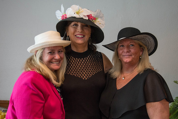 Desi Smith/Staff photo Reneau Longoria of Rockport, Eileen Egan and Michelle Boudrot both of Manchester, attend the Manchester Essex Rotary's Kentucky Derby Party and Auction held at the American Legion Hall in Manchester Saturday night.       May 7,2016