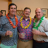 Desi Smith/Staff photo.   From left to right, Whit Hammett,Peter Croker and Scott Falk, all from Essex, attended the beach-themed Spaulding Education Fund's Winter Beach Blast on Friday, March 18,2016 at the Manchester Legion Hall in Manchester.