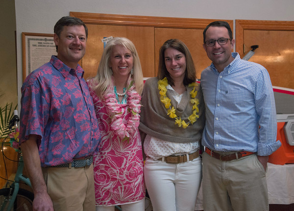 Desi Smith/Staff photo.   From left to right, Peter and Abby Crocker and Meghan and Owen Nichols all from Manchester, attended the beach-themed Spaulding Education Fund's Winter Beach Blast on Friday, March 18,2016 at the Manchester Legion Hall in Manchester.