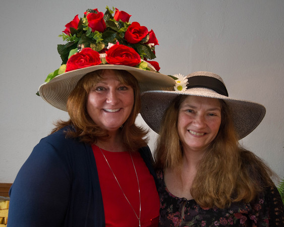 Desi Smith/Staff photo.     Cathy Mills of Gloucester and Laurie Occhipinti of Salem attend the Manchester Essex Rotary's Kentucky Derby Party and Auction held at the American Legion Hall in Manchester Saturday night.       May 7,2016