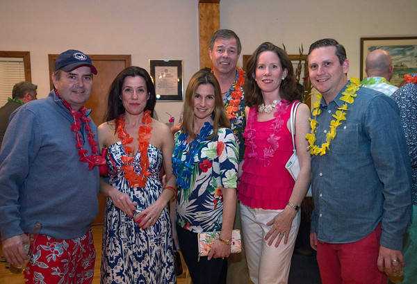 Desi Smith/Staff photo.   From left to right, Auther and Edlira McCue, Denise Sanson, Joe and Sheila Coughlin and Diego Sanson all from Manchester, attended the beach-themed Spaulding Education Fund's Winter Beach Blast on Friday, March 18,2016 at the Manchester Legion Hall in Manchester.