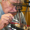 Photo/Reba Saldanha   Curt Hill of Danvers works on a replica of the Essex during a model ship building class at Peabody's senior center Sept 12, 2016.