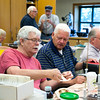 Photo/Reba Saldanha  Ed Croughwell of Peabody, left, and Normand Sanborn of Amesbury work together during a model ship building class at Peabody's senior center Sept 12, 2016.