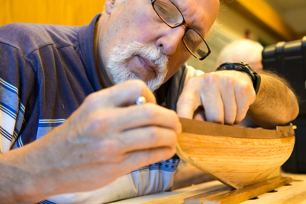 Photo/Reba Saldanha  George LeBlanc works on the Bluenose II during a model ship building class at Peabody's senior center Sept 12, 2016.