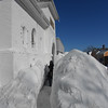 Gail McCarthy/Staff photo<br /> A Rockport resident takes a break from shoveling the sidewalk in front of his condo at 7 Main St.formerly the town's Christian Science church, on Feb. 16. 2015. Traveling by foot on Cape Ann was akin to going through tunnels