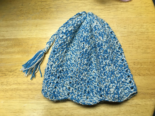 """ANDREA HOLBROOK/Staff photo<br /> Handknit """"waves"""" hat, $20, Hooked."""