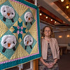 Desi Smith Photo.   Jeannine Lynch stands next to one of her pieces on display at Middle Street Trinity Congregational Church Sunday morning. Lynch is a member of a local chapter of the Linus Project, that has been in service for 8 years. A group of local volunteers meet monthly, to work on creating blankets that are then donated to sick children by the Linus Project. September 18,2016