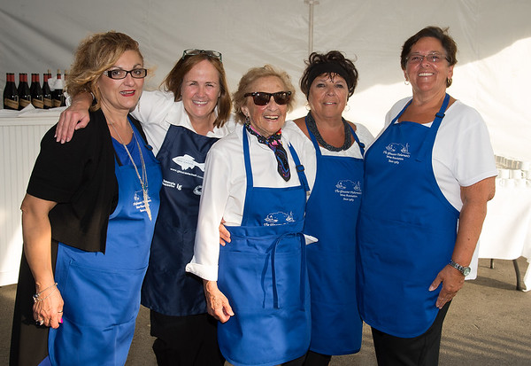"""Desi Smith Photo.   Just some of the volunteers from the Gloucester Fishermen's Wives Association that helped out to serve during the """"Sea to Supper"""" community dinner to benefit the Gloucester Fishermen's Wives Association,that was held on August 25,2016 at the Waterfront Pavilion Tent at Mile Marker One Restaurant and Bar. From left to right are, Maria Cannavo, Marcia O'Brien, Selma Bell, Kathleen Santuccio and Karen Cunhathe all from Gloucester."""