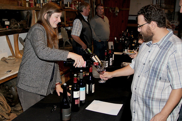 Angelina Gendall representing Baystate Wine & Spirits, serves Justin Demetri from Gloucester some wine at the Annual Wine Tasting and Acution at the Essex Shipbuilding Museum, Essex.