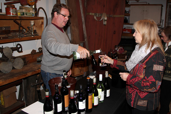 Derek Ellerkamp representing Ruby Wines, serves Allene Maginn some wine at the Annual Wine Tasting and Acution at the Essex Shipbuilding Museum, Essex.