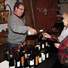 Derek Ellerkamp representing Ruby Wines, serves Allene Maginn some wine at the Annual Wine Tasting and Acution at the Essex Shipbuilding Museum, Essex.