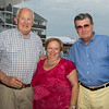 "Desi Smith Photo.    Former Gloucester Mayor John Bell, Gloucester Fishermen's Wives Association president Anglia Sanfilippo and Paul Zink all of Gloucester attended the ""Sea to Supper"" community dinner to benefit the Gloucester Fishermen's Wives Association held on August 25,2016 at the Waterfront Pavilion Tent at Mile Marker One Restaurant and Bar."