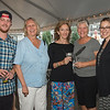 "Desi Smith Photo.    From left to right, Mike Duggan,Valerie Nelson, Molly Luccauage,Kate Noonan,and Sarah Boshco, all from Gloucester, attended the ""Sea to Supper"" community dinner to benefit the Gloucester Fishermen's Wives Association held on August 25,2016 at the Waterfront Pavilion Tent at Mile Marker One Restaurant and Bar."