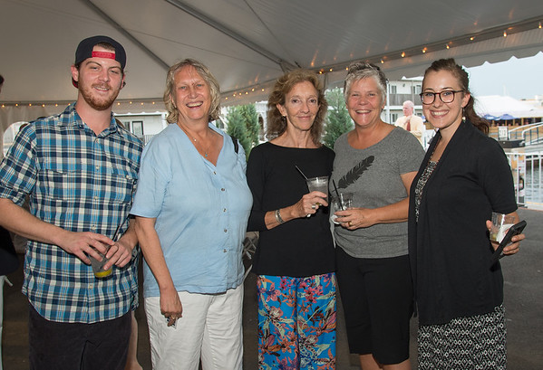 """Desi Smith Photo.    From left to right, Mike Duggan,Valerie Nelson, Molly Luccauage,Kate Noonan,and Sarah Boshco, all from Gloucester, attended the """"Sea to Supper"""" community dinner to benefit the Gloucester Fishermen's Wives Association held on August 25,2016 at the Waterfront Pavilion Tent at Mile Marker One Restaurant and Bar."""