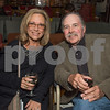 DESI SMITH/Staff photo. Jane and Rocky Forsyth of Rockport settle into their seats with a glass of wine at the New England premiere of Israel Horovitz's 'My Old Lady' held at Cape Ann Community Cinema on Main Street Sept 15,2014.