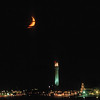 orange crescent moon over Provincetown