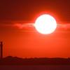sun setting over Pilgrim Monument