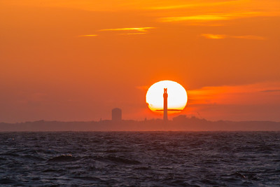sun setting behind Pilgrim Monument & windblown sea