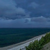 dark stormy panorama with modern clifftop house