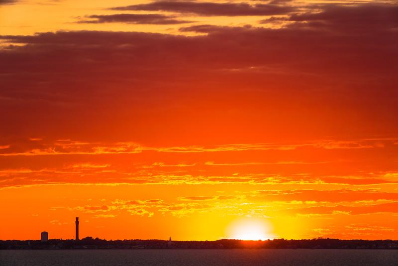 orange sky behind Ptown