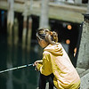 Vietnamese girl fishing for squid Provincetown Harbor