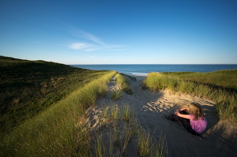 Rebecca looking at No-Name Beach Truro Atlantic coast