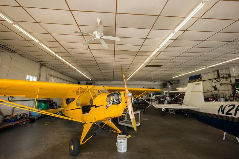 yellow plane wooden propeller in Chatham airport hangar