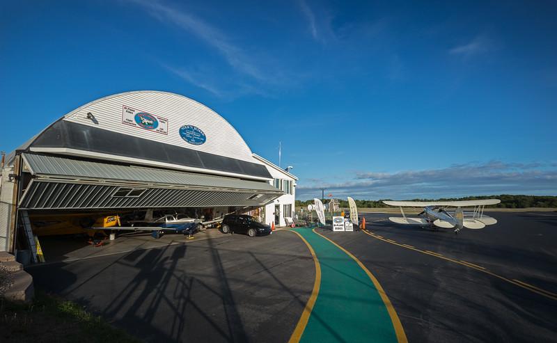 Chatham Airport hangar with Waco biplane