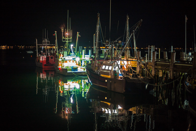three fishing boats nighttime Provincetown Harbor