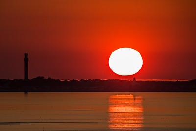 big sun setting over Ptown