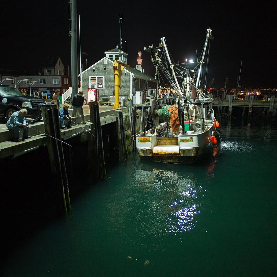 fishing off MacMillan Wharf at night near Paul Jean scallp boat