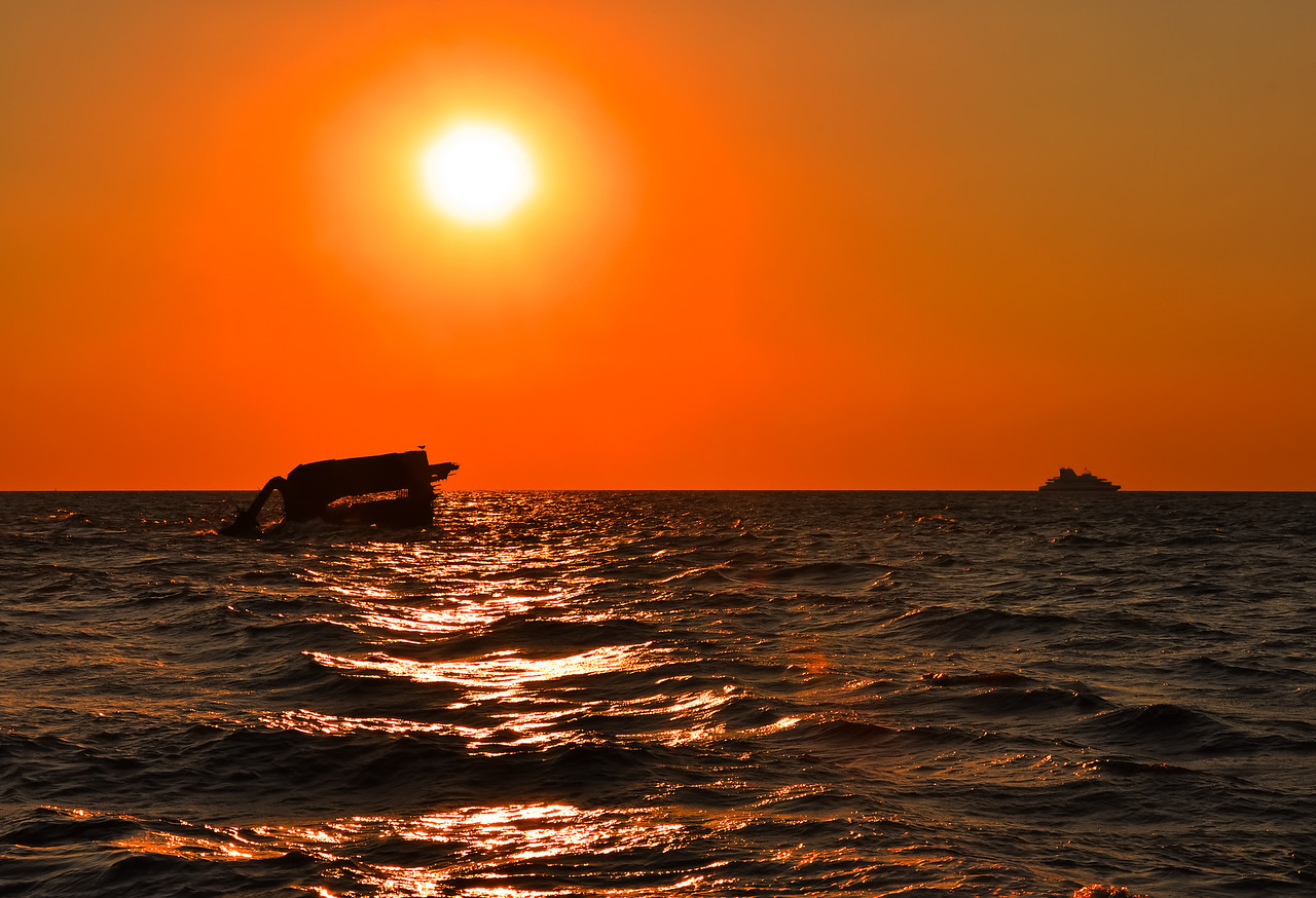 Sunset over SS Atlantus Shipwreck and Ferry in Background, Cape May, New Jersey