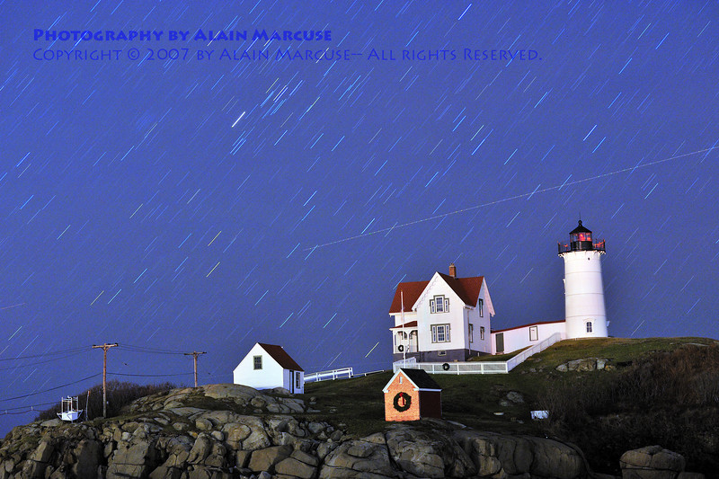 Stars streaking through the night sky at Nubble Lighthouse