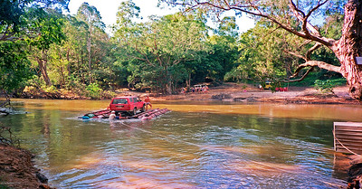 The crew take Ivor's Toyota FourRunner 4x4 over the Wenlock River