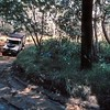 Barbara Harris lines the mighty Diahatsu 4x4 up to slide around the slippery corner. Fun!
