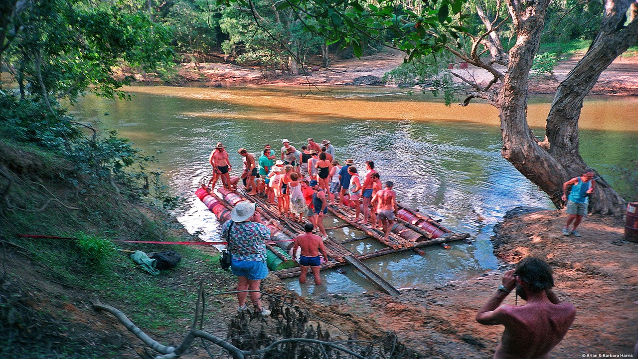 Ballast test of the just completed 4x4 vehicle raft. Barbara in red top. Wenlock River. June 1989,