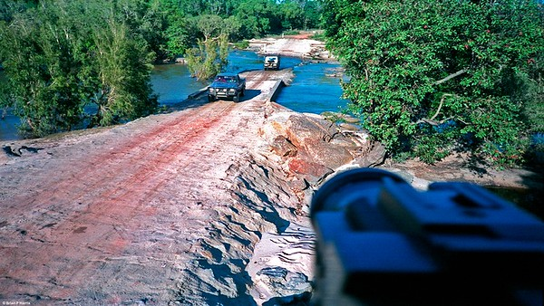 Neil driving his Toyota Hilux & Barbara in our Diahatsu F-55 4x4 cross the Archer River heading north to Cape York.