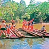 May 1989 the raft building guys test it in the Wenlock River. Southern loading area is just to the right. Locating wire rope will tie to big tree at beach.