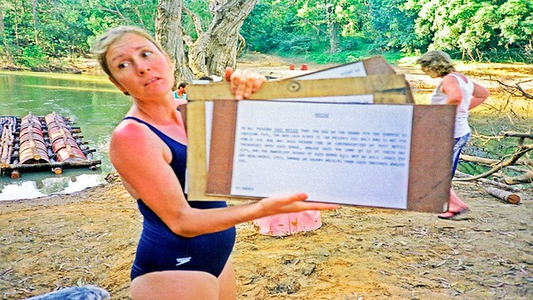 Mary-Anne with the notice for all users of the raft. It was nailed to a tree by the river. Apparently she & Scotty later had two children