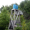 Water tower and shower stall.
