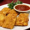 Capellini's Restaurant's appetizers Toasted Ravioli which consists of breaded cheese raviloi with marinara sauce at the restaurant in Tewksbury on Wednesday afternoon. SUN/JOHN LOVE