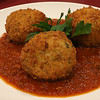 Capellini's Restaurant's appetizers spinach arancini which consists of aroborio rice balls, fresh spinach and cheese over bolognese at the restaurant in Tewksbury on Wednesday afternoon. SUN/JOHN LOVE