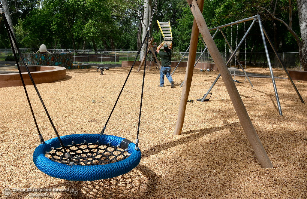 . A blue net swing is seen while City of Chico workers put the finishing touches on the new swing section at Caper Acres Thursday May 10, 2018. New things include a bridge near the entrance, swings, a teeter totter and more. The new Swing Adventure Area Grand Opening is Saturday May 12 at 9:00 a.m.. (Bill Husa -- Enterprise-Record)