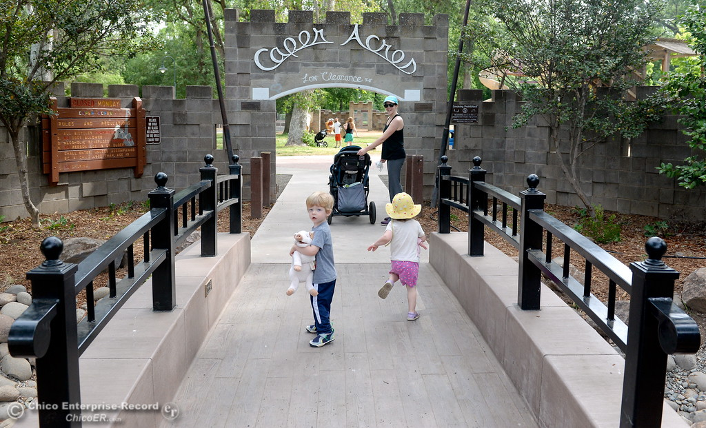 . Kristina Besnard of Chico walks across a new bridge near the entrance with her 2-year-old twins Archer and Vivian at Caper Acres Thursday May 10, 2018. New things include a bridge near the entrance, swings, a teeter totter and more. The new Swing Adventure Area Grand Opening is Saturday May 12 at 9:00 a.m.. (Bill Husa -- Enterprise-Record)