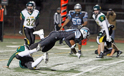 Los Alamos' Kayden Rivera, number 9, tackles Capital's Estevan Segura, number 33, during the second quarter of the Capital High School vs Los Alamos High School football game at Capital on Friday, November 3, 2017. Luis Sánchez Saturno/The New Mexican