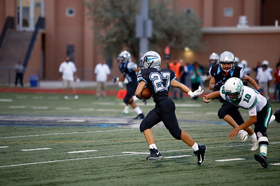 Capital's Daniel Roybal, number 27, gets through Pojoaque's defense during the first quarter of the Capital High School vs Pojoaque Valley High School at Capital on Friday August 24, 2018. Luis Sánchez Saturno/The New Mexican
