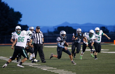 Capital's Jasper Mares, number 23, gets through the Pojoaque defense during the first quarter of the Capital High School vs Pojoaque Valley High School at Capital on Friday August 24, 2018. Luis Sánchez Saturno/The New Mexican