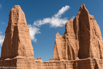 A cloud passes between pinnacles in Cathedral Valley.